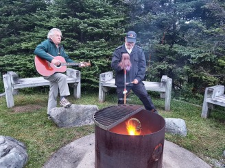 playing guitar and ugly stick in Gros Morne Park in Newfoundland