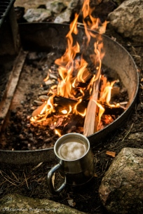 cup of coffee by the campfire