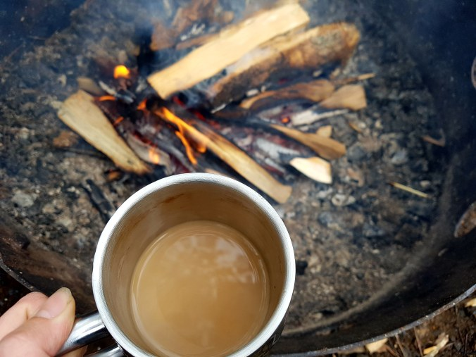 cup of coffee near the campfire