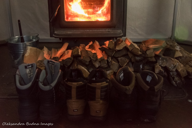 boots in front of a wood stove in a yurt in Silent Lake Provincial Park
