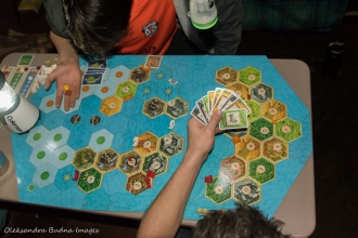playing settlers of catan in a yurt in Silent Lake