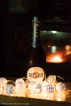 champaign with christmas lights and fire in the background