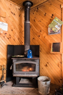 cooking on a wood stove in La Cigale rustic shelter in parc national d'Aiguebelle