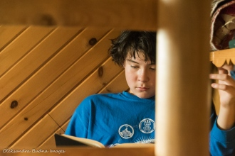 reading inside La Cigale rustic shelter in Parc National d'Aiguebelle