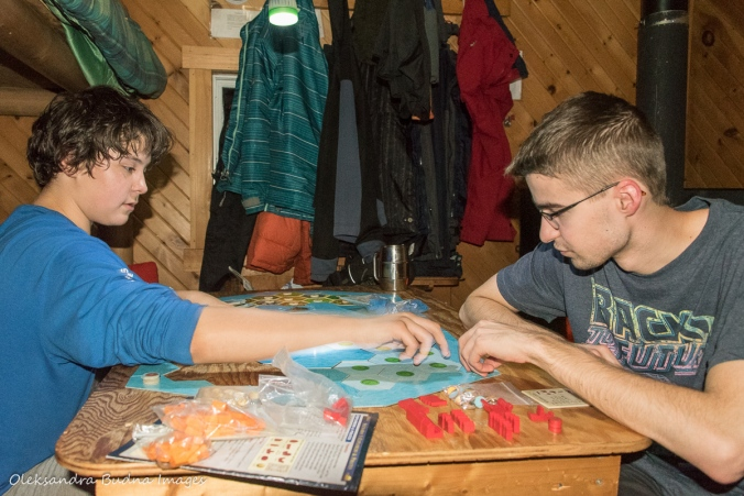 playing board games inside La Cigale rustic shelter in Parc National d'Aiguebelle