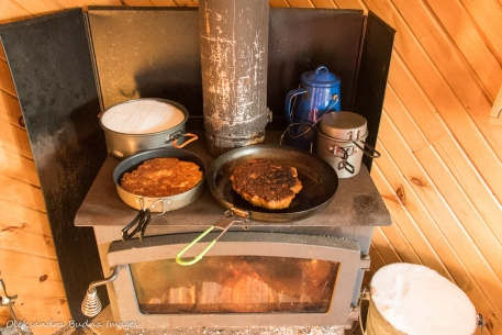 cooking on a wood stove in La Cigale cabin in Parc National d'Aiguebelle