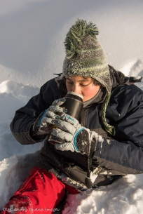 drinking tea on the trail in the winter