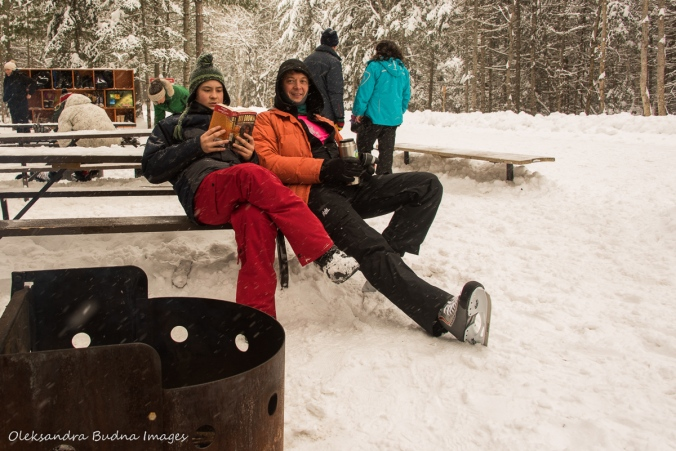 resting by the fire after skating in Arrowhead Provincial Park
