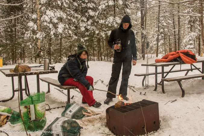 warming by the fire along the trail in Arrowhead Provincial Park in the winter