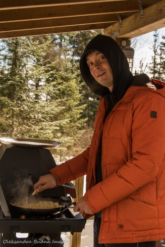 cooking breakfast outside at Windy Lake Provincial Park in the winter