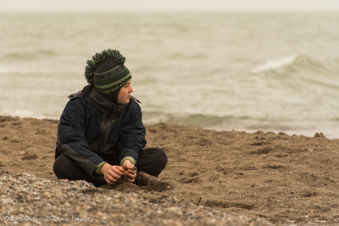 child sitting on a beach