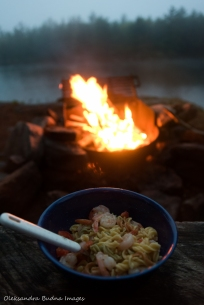 pasta with shrimp and peppers near the campfire