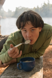 eating oatmeal at the campsite