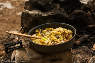 scrambled eggs with mushrooms and peppers on the rock