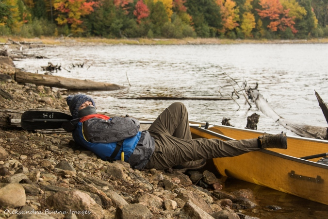 kid lying by the canoe ready to depart
