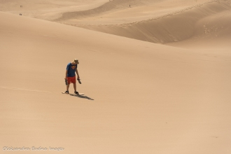 sandboarding at Great Sand Dunes National Park in Colorado