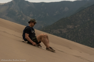 sand sledding at Great Sand Dunes National Park in Colorado