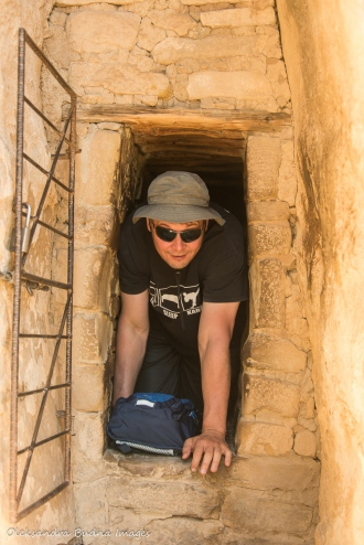 crawling through a tunnel at Balcony House in Mesa Verde