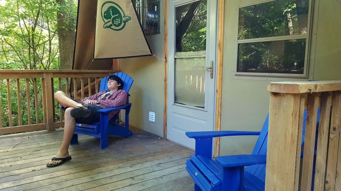 relaxing in front of oTENTik in Point Pelee