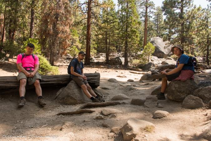 taking a break while hiking Half Dome tril in Yosemite