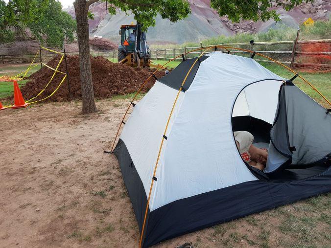 tent on campsite 45 next to an excavatorat Capitol Reef