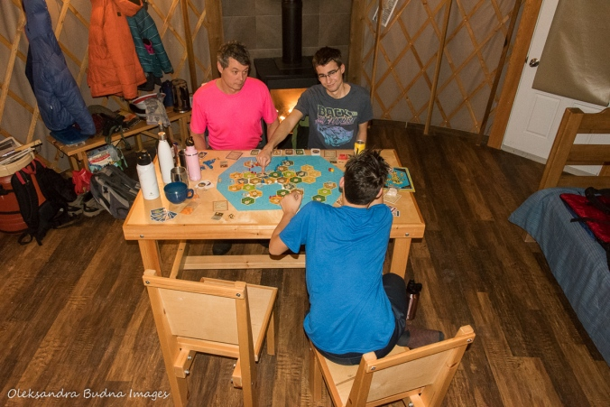 playing a board game inside yurt 46 at MacGregor Point