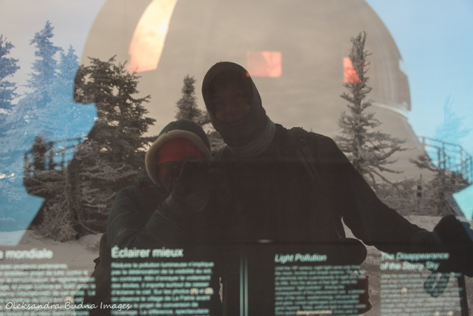 taking a photo of a reflection in the information panel at Mont-Mégantic observatory