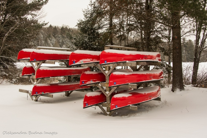 canoes on a rack at silent lake provincial park in the winter