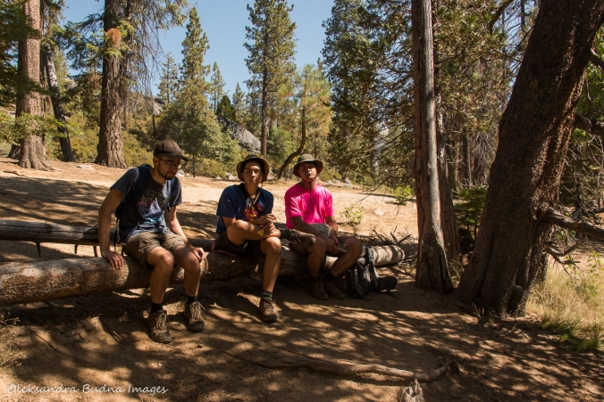taking a break near Merced River while hiking the Half Dome trail