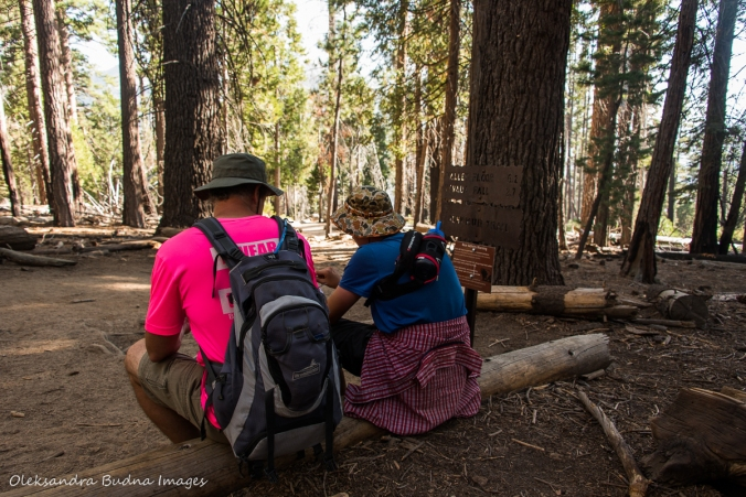 taking a break while hiking the Half Dome trail