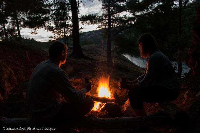 sitting by the campfire at campsite 52 on Three Narrows Lake in Killarney