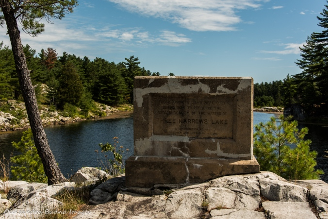 stone commemorating building dams on Three Narrows Lake in Killarney