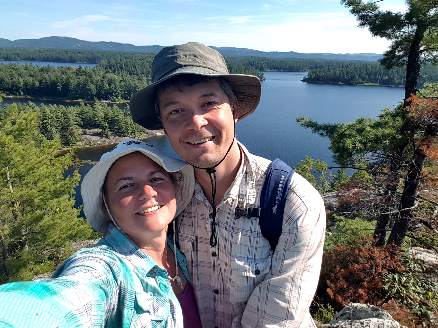 selfie from the cliff with Three Narrows Lake in the background