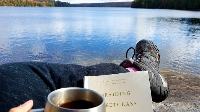 book, coffee and view of the lake