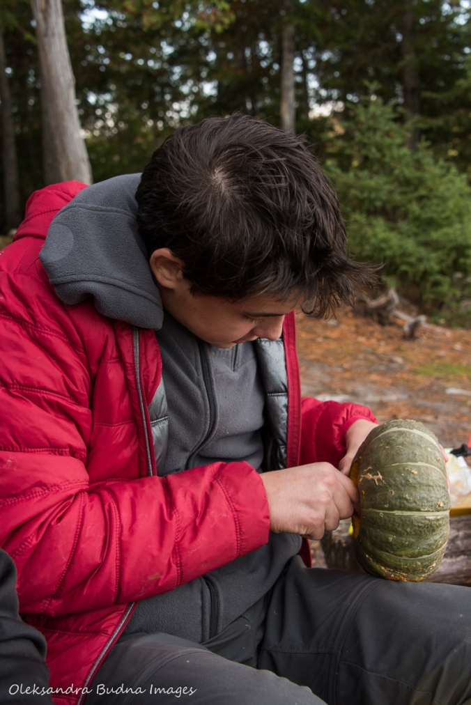 cleaning out a buttercup squash at a campsite