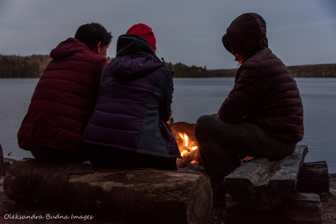 sitting by the cmapfire on Lake Louisa in Algonquin