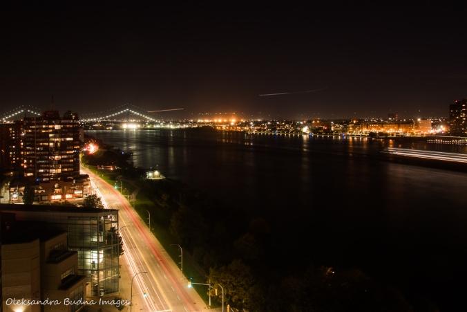 view of Detroit river and Ambassador Bridge at night