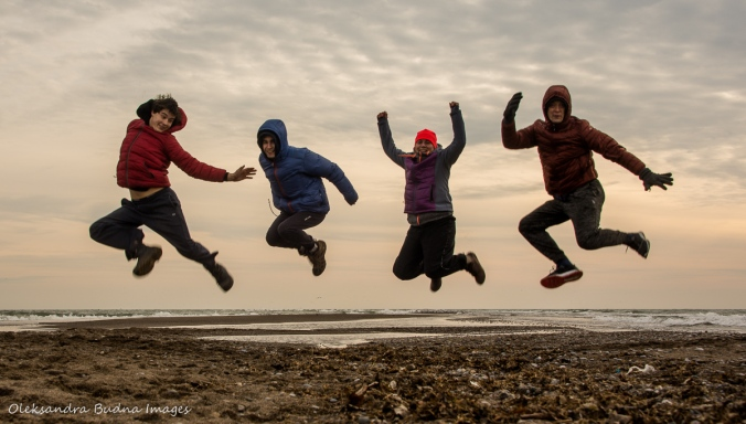 jumping at the tip at Point Pelee National Park