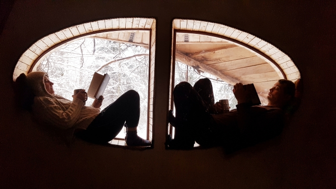 reading in the Hobbit House at Les Toits du Monde