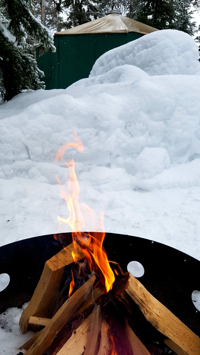 campfire near the yurt at Windy Lake in the winter