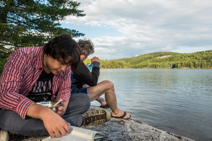 sitting by the water on campsite 143 on Nellie Lake in Killarney