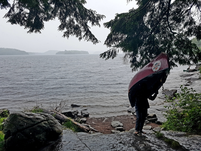 portaging in the rain from manitou Lake to norh tea lake in algonquin