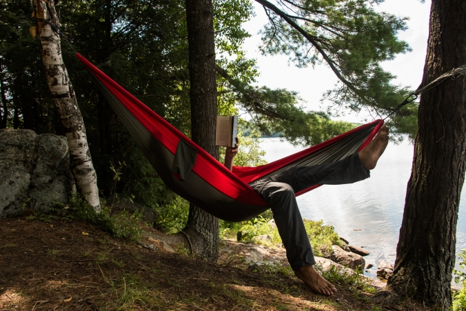 reading a hammock on a campsite on Manitou Lake in Algonquin