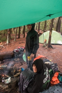 huddling under a tarp in the backcountry