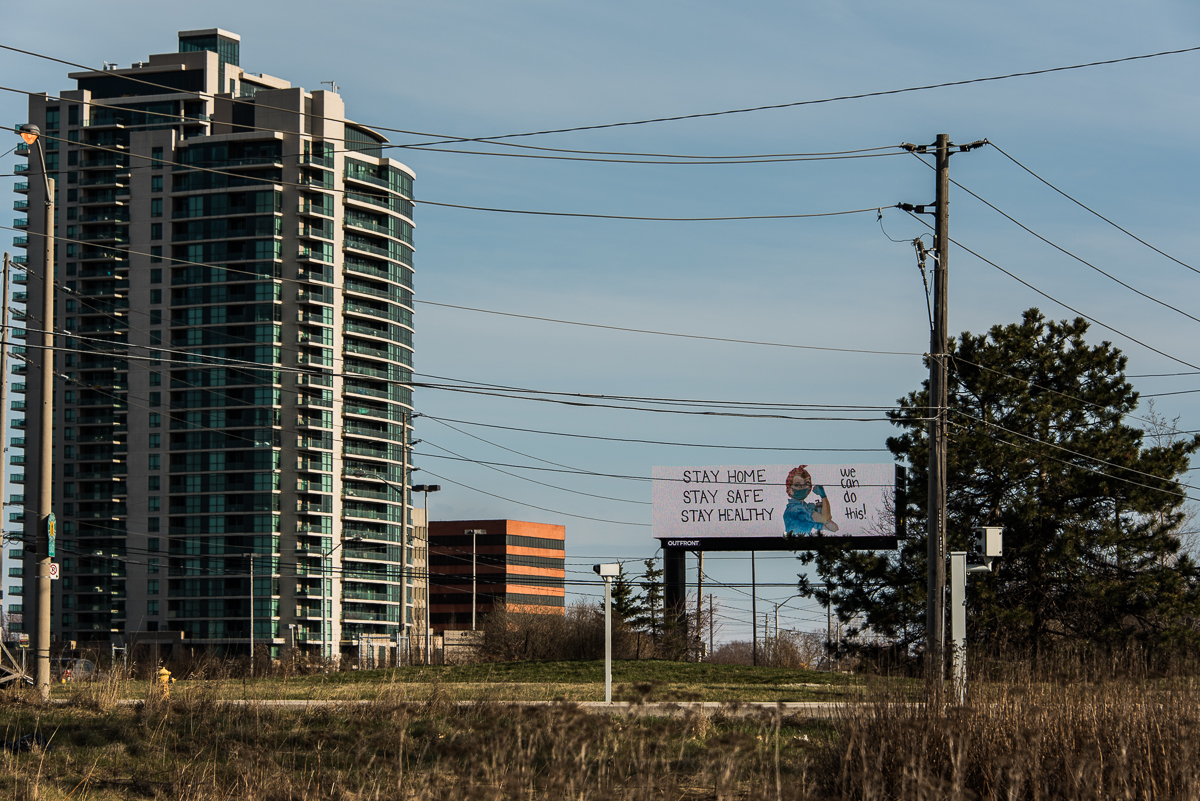billboard about COVID in Toronto