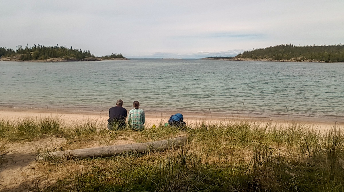 taking a break at Fish Harbour while backpacking in Pukaskwa