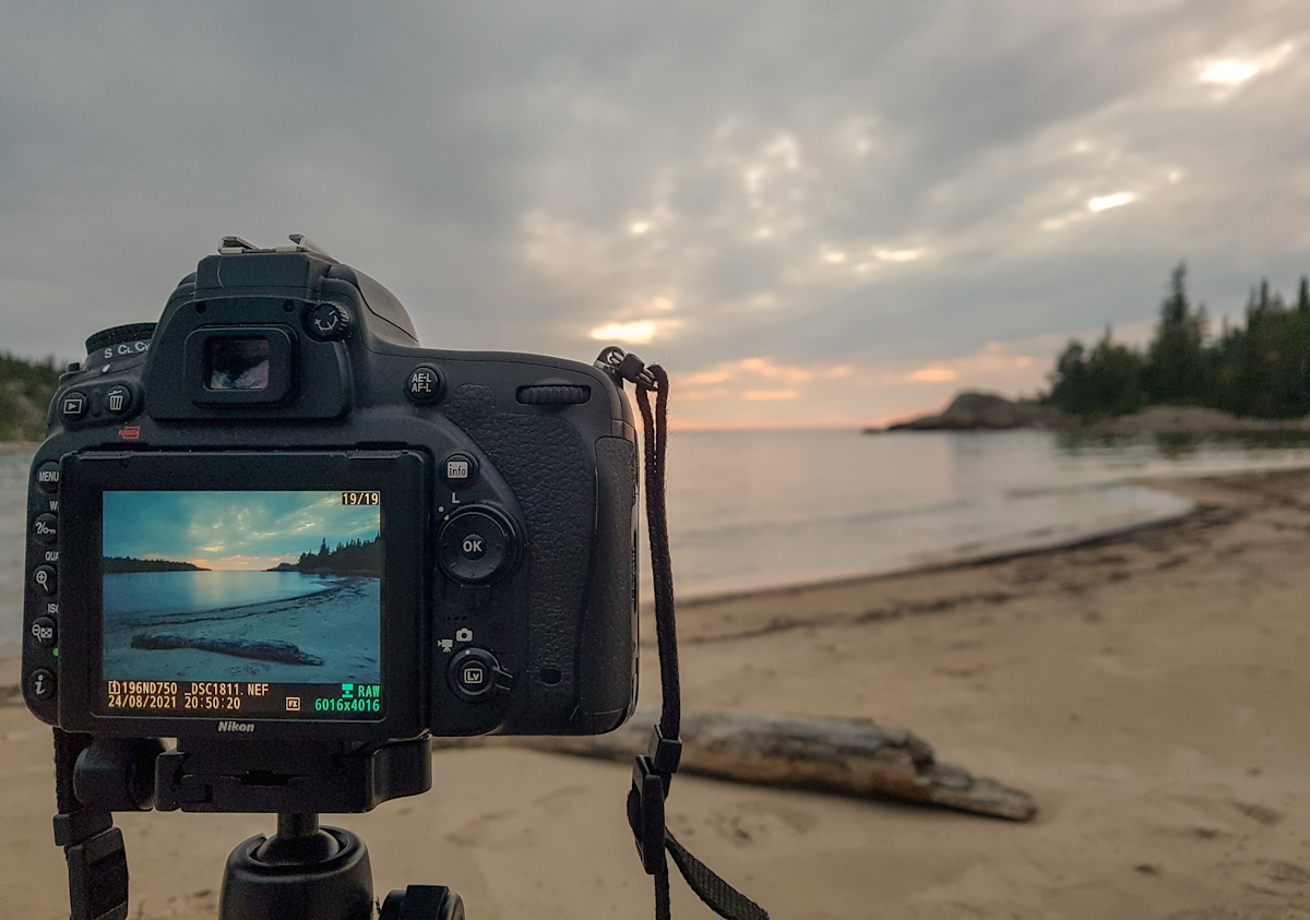photographing sunset at Willow River in Pukaskwa