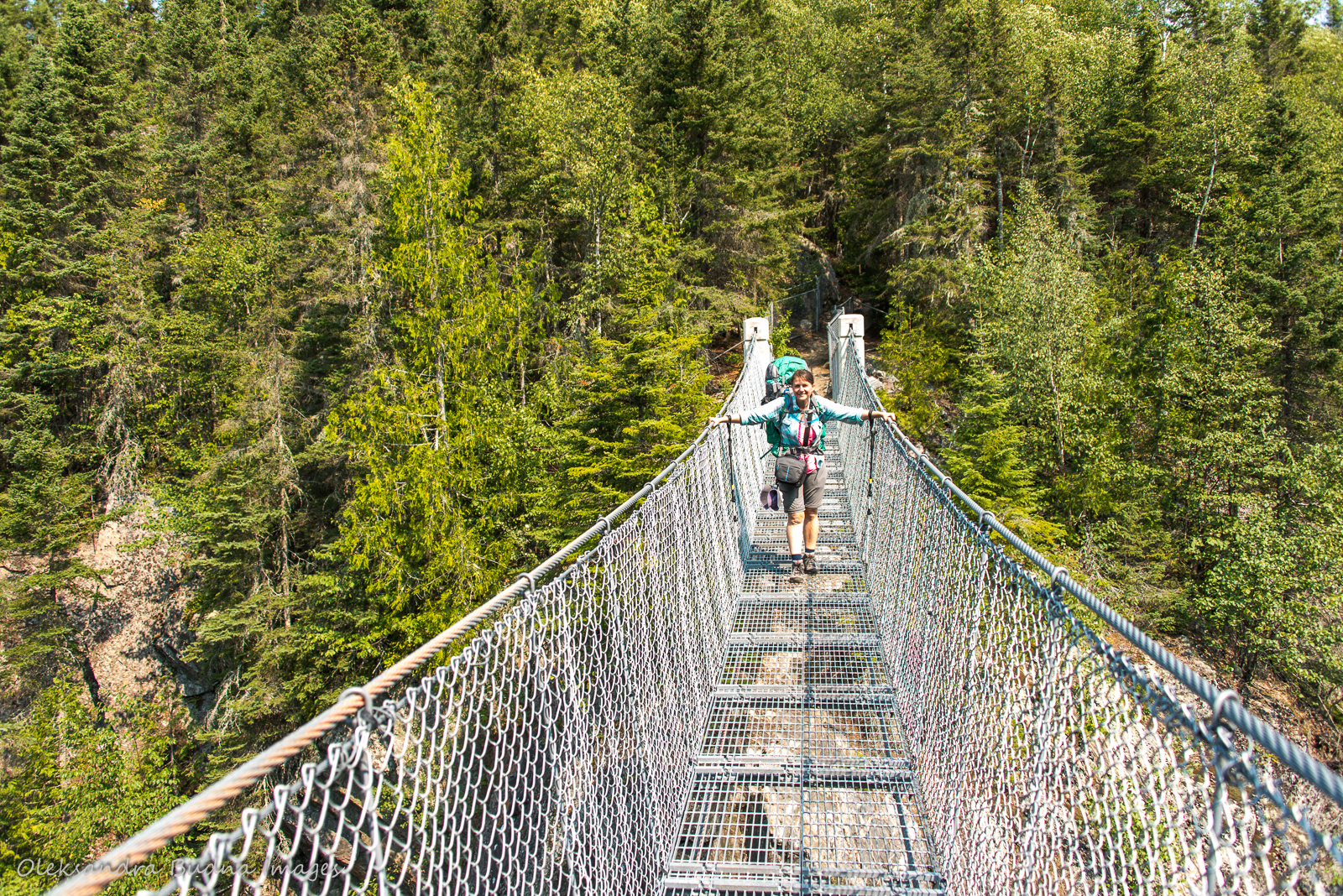 crossing suspension bridge over White River in Pukaskwa