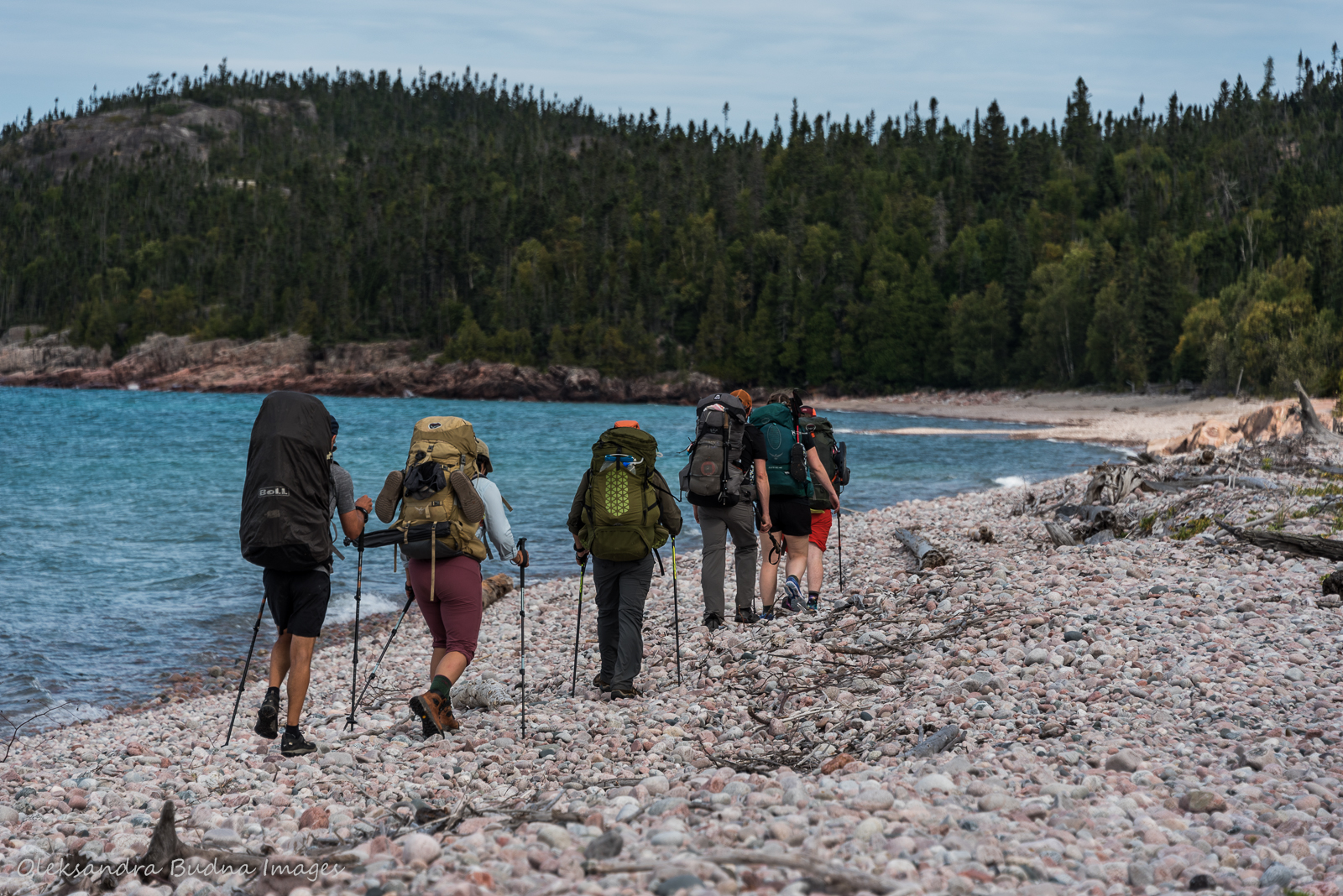 a group of hikers on White Gravel River beach in Pukaskwa