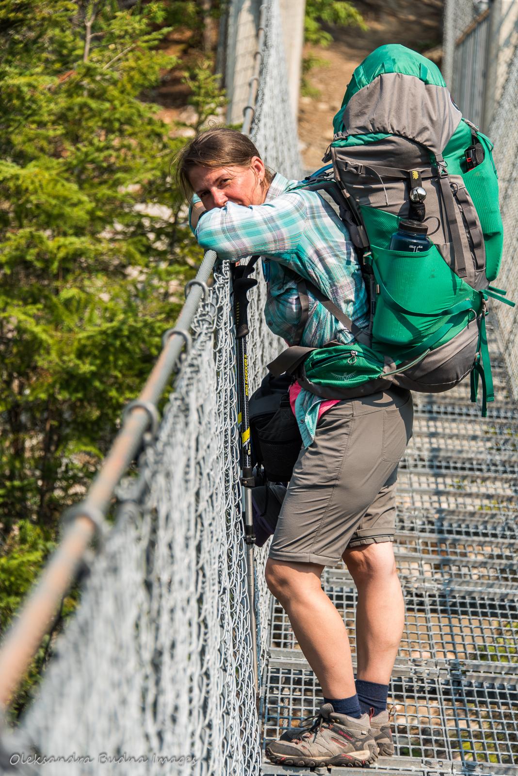 crossing suspension bridge over Chigaamiwinigum Falls in Pukaskwa